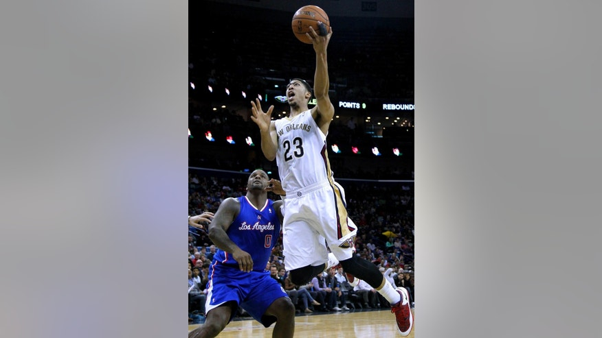 New Orleans Pelicans forward Anthony Davis (23) drives past Los Angeles Clippers forward Glen Davis (0) during the second half of an NBA basketball game in New Orleans, Wednesday, March 26, 2014. The Pelicans won 98-96. (AP Photo/Jonathan Bachman)