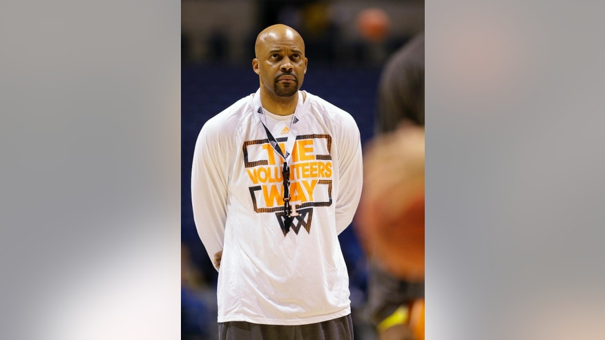 Tennessee head coach Cuonzo Martin watches his team during practice for the NCAA Midwest Regional semifinal college basketball tournament game Thursday, March 27, 2014, in Indianapolis. Tennessee plays Michigan on Friday, March 28, 2013. (AP Photo/Michael Conroy)