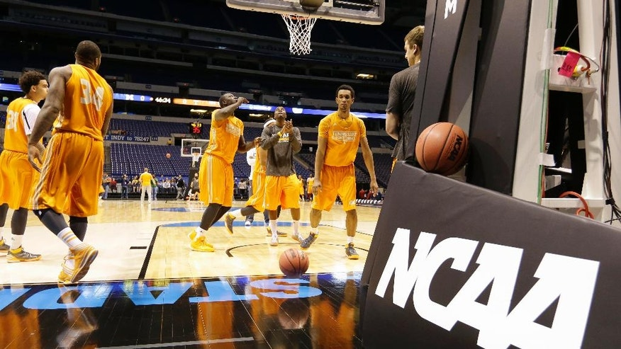 Tennessee players warm up during practice for their NCAA Midwest Regional semifinal college basketball tournament game Thursday, March 27, 2014, in Indianapolis. Tennessee plays Michigan on Friday, March 28, 2013. (AP Photo/Michael Conroy)