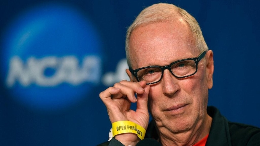 San Diego State head coach Steve Fisher listens to a question during a news conference at the NCAA college basketball tournament, Wednesday, March 26, 2014, in Anaheim, Calif. San Diego State is scheduled to play Arizona on Thursday in a regional semifinal. (AP Photo/Mark J. Terrill)