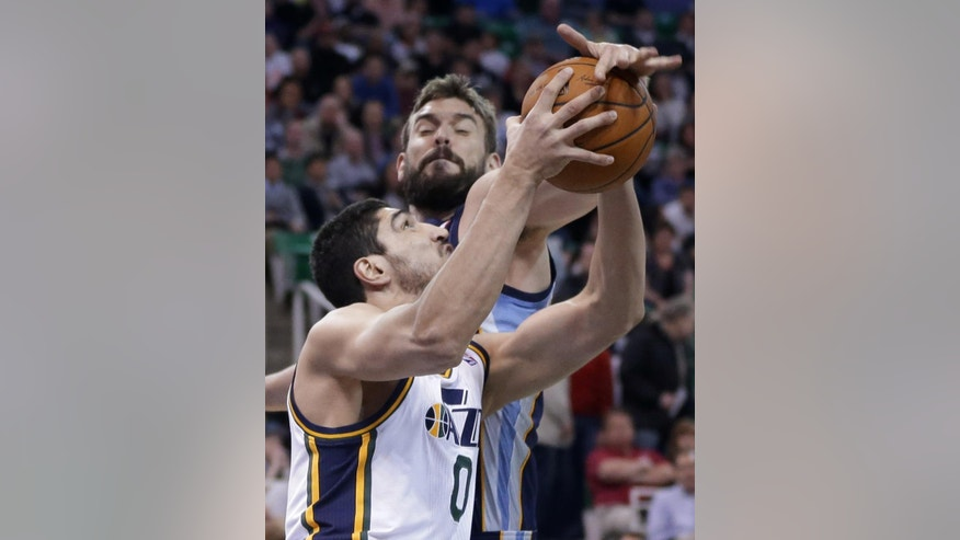 Memphis Grizzlies' Marc Gasol, rear, of Spain, defends Utah Jazz's Enes Kanter (0), of Turkey, during the first quarter of an NBA basketball game Wednesday, March 26, 2014, in Salt Lake City. (AP Photo/Rick Bowmer)