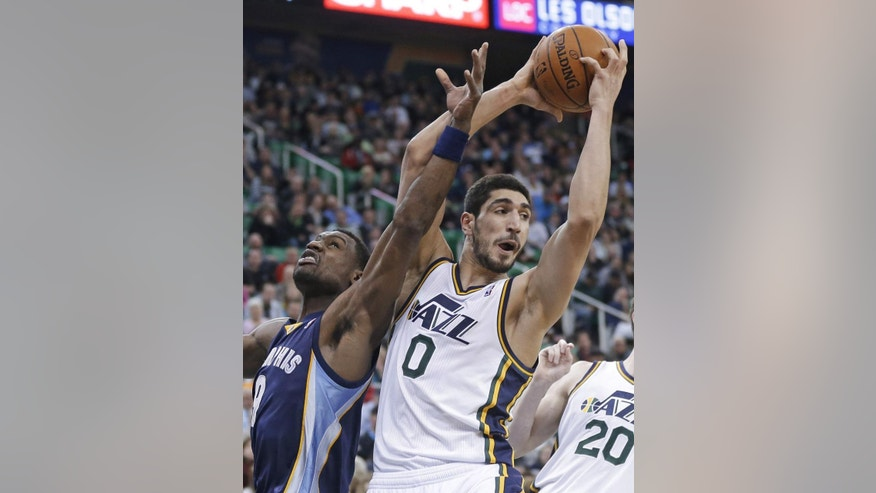 Utah Jazz's Enes Kanter (0), of Turkey, pulls down a rebound as Memphis Grizzlies' Tony Allen (9) defends during the second quarter of an NBA basketball game Wednesday, March 26, 2014, in Salt Lake City. (AP Photo/Rick Bowmer)