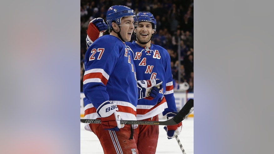 New York Rangers' Ryan McDonagh (27) celebrates his goal with Dan Girardi during the second period of an NHL hockey game against the Philadelphia Flyers on Wednesday, March 26, 2014, in New York. (AP Photo/Frank Franklin II)