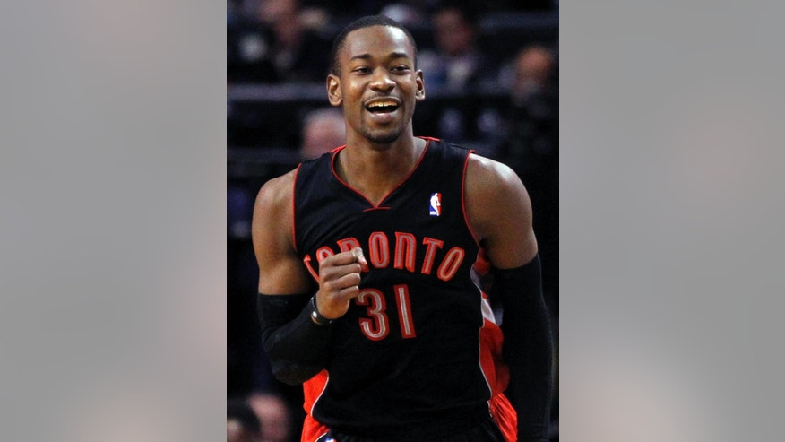Toronto Raptors forward Terrence Ross (31) celebrates his three-point shot against the Boston Celtics late in the fourth quarter of an NBA basketball game in Boston, Wednesday, March 26, 2014. Ross scored 24 points to lead the Raptors to a 99-90 victory. (AP Photo/Elise Amendola)