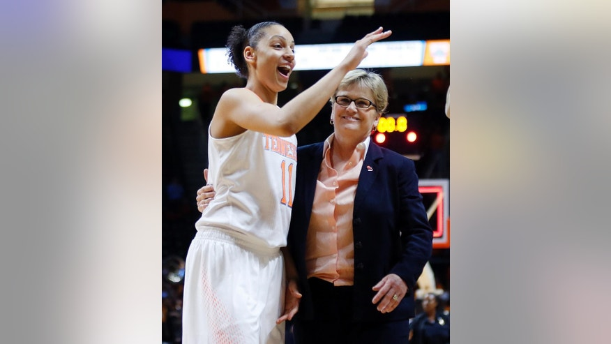 Tennessee head coach Holly Warlick leaves the court with forward Cierra Burdick (11) after an NCAA women's college basketball second-round tournament game against St. John's Monday, March 24, 2014, in Knoxville, Tenn. Burdick led Tennessee with 21 points as they won 67-51. (AP Photo/John Bazemore)
