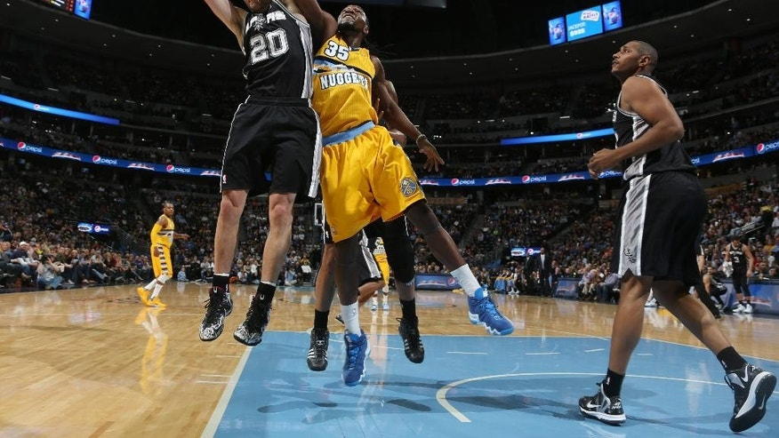 From left, San Antonio Spurs guard Manu Ginobili (20), of Argentina, pulls in a rebound in front of Denver Nuggets forwards Kenneth Faried and Boris Diaw, of France, in the first quarter of an NBA basketball game in Denver, Friday, March 28, 2014. (AP Photo/David Zalubowski)
