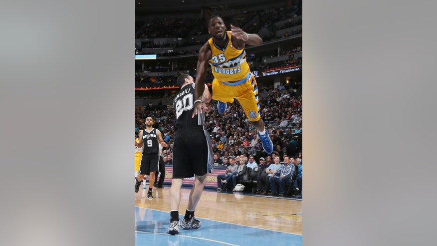 Denver Nuggets forward Kenneth Faried, front, is sent flying as he is fouled by San Antonio Spurs guard Manu Ginobili (20), of Argentina, while driving the lane for a shot in the first quarter of an NBA basketball game in Denver, Friday, March 28, 2014. (AP Photo/David Zalubowski)