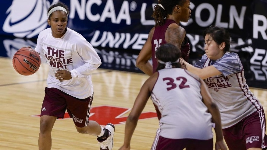 Texas A&M's Jordan Jones, left, participates in NCAA college basketball practice in Lincoln, Neb., Friday, March 28, 2014. Texas A&M will play DePaul in an NCAA Lincoln Regional women's semifinal basketball game on Saturday. (AP Photo/Nati Harnik)
