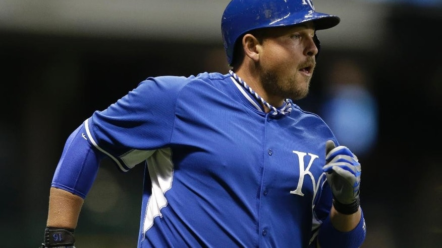 Kansas City Royals' Billy Butler rounds the bases after his home run in the fifth inning of an exhibition baseball game against the Milwaukee Brewers Friday, March 28, 2014, in Milwaukee. (AP Photo/Jeffrey Phelps)