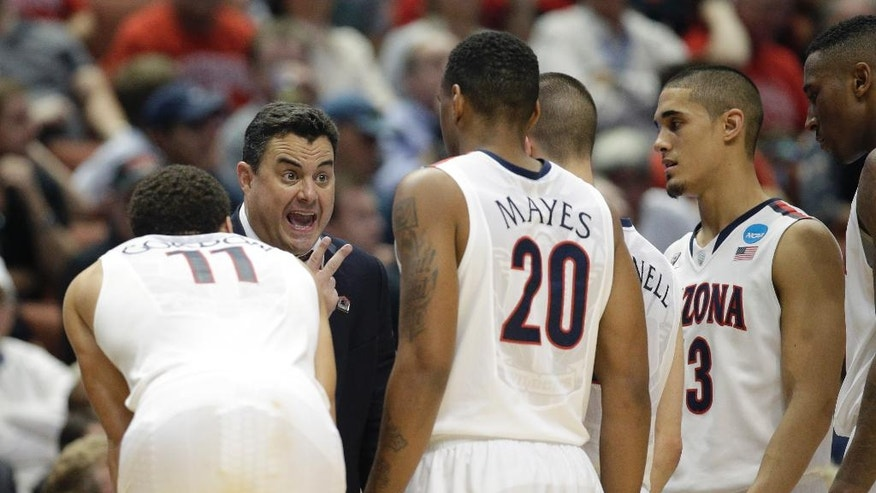 Arizona head coach Sean Miller talks to Arizona forward Aaron Gordon (11), and Jordin Mayes (20) during the second half in a regional semifinal NCAA college basketball tournament game against San Diego State, Thursday, March 27, 2014, in Anaheim, Calif. (AP Photo/Jae C. Hong)