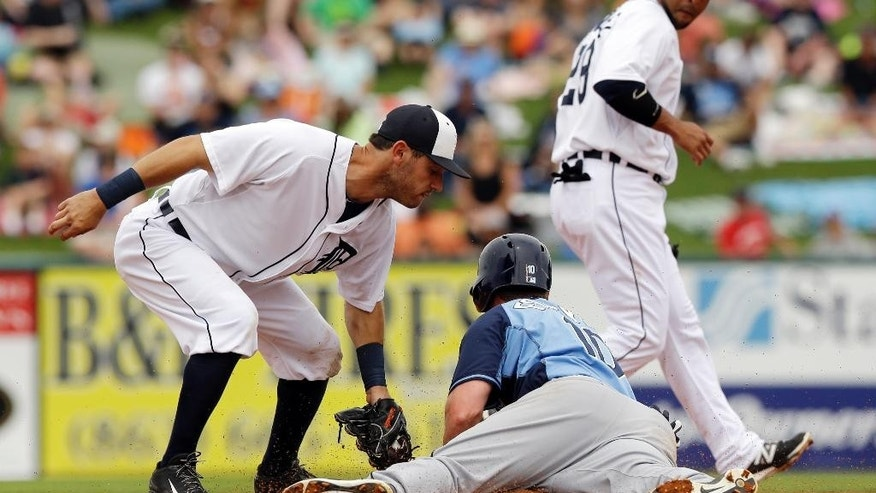Tampa Bay Rays' Logan Forsythe , front right, slides under the tag of Detroit Tigers second baseman Ian Kinsler, left, to steal second during the second inning of a spring exhibition baseball game in Lakeland, Fla., Friday, March 28, 2014. (AP Photo/Carlos Osorio)