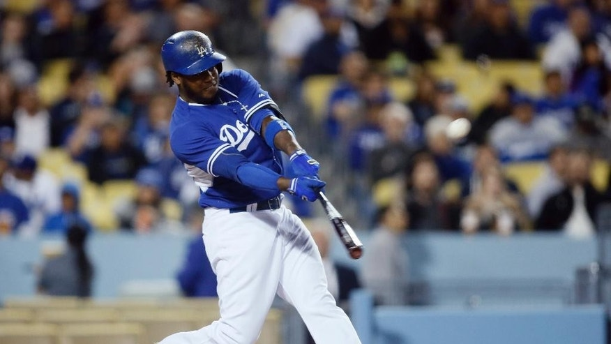 Los Angeles Dodgers' Hanley Ramirez hits a solo home run against the Los Angeles Angels during the third inning of an exhibition baseball game in Los Angeles, Thursday, March 27, 2014. (AP Photo/Danny Moloshok)