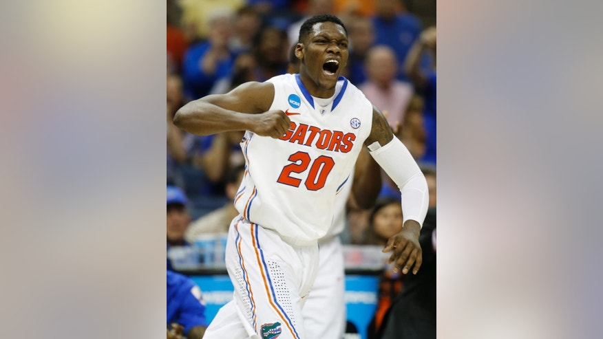 Florida guard Michael Frazier II (20) celebrates a goal against UCLA during the second half in a regional semifinal game at the NCAA college basketball tournament, Thursday, March 27, 2014, in Memphis, Tenn. Florida won 79-68. (AP Photo/John Bazemore)