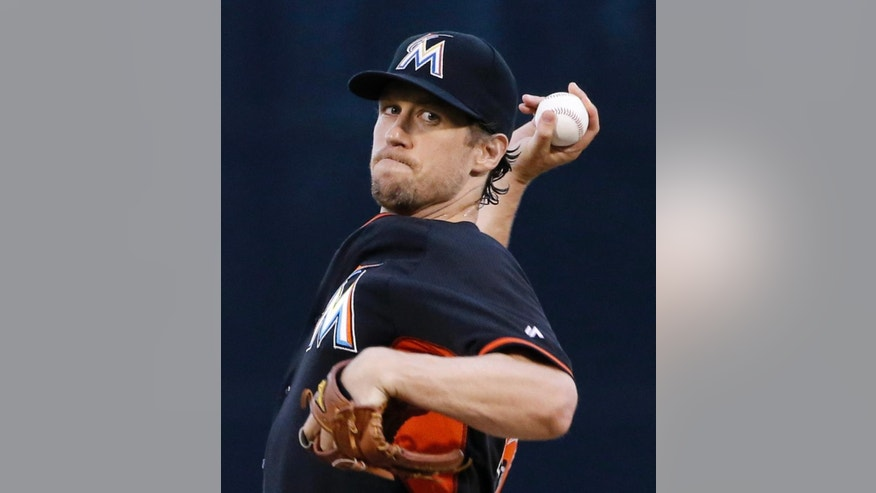 Miami Marlins starting pitcher Kevin Slowey delivers a warmup pitch before a spring exhibition baseball game against the New York Yankees in Tampa, Fla., Friday, March 28, 2014.  The Yankees defeated the Marlins 3-0. (AP Photo/Kathy Willens)
