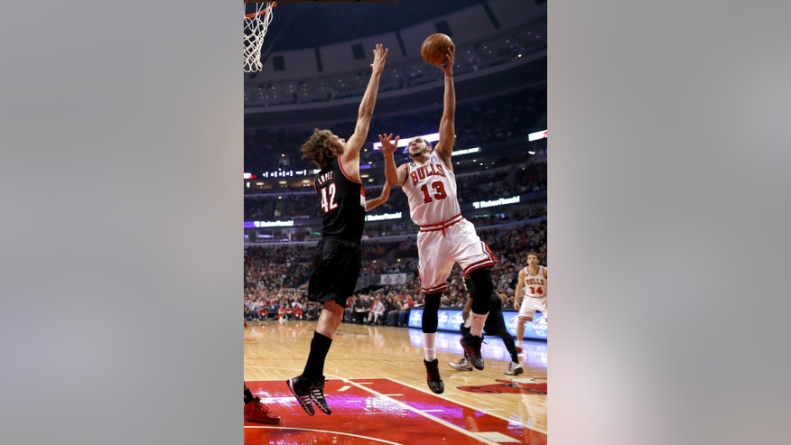 Chicago Bulls center Joakim Noah (13) shoots over Portland Trail Blazers center Robin Lopez (42) during the first half of an NBA basketball game Friday, March 28, 2014, in Chicago. (AP Photo/Charles Rex Arbogast)