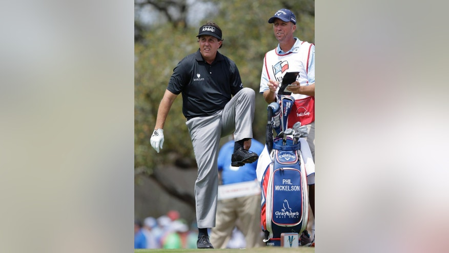 "Phil Mickelson, left, with his caddie, Jim ""Bones"" Mackay, waits to hit on the second hole during the second round of the Texas Open golf tournament, Friday, March 28, 2014, in San Antonio. (AP Photo/Eric Gay)"
