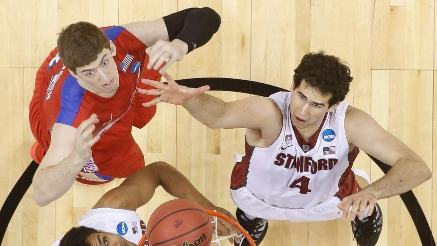 Stanford center Stefan Nastic (4) and Dayton forward/center Matt Kavanaugh (35) vie for a loose ball during the first half in a regional semifinal game at the NCAA college basketball tournament, Thursday, March 27, 2014, in Memphis, Tenn. (AP Photo/John Bazemore)