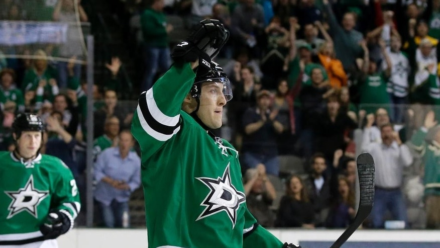 Dallas Stars' Ryan Garbutt, front, celebrates his goal against the Nashville Predators as Cody Eakin, left rear, watches in the first period of an NHL hockey game, Friday, March 28, 2014, in Dallas. (AP Photo/Tony Gutierrez)