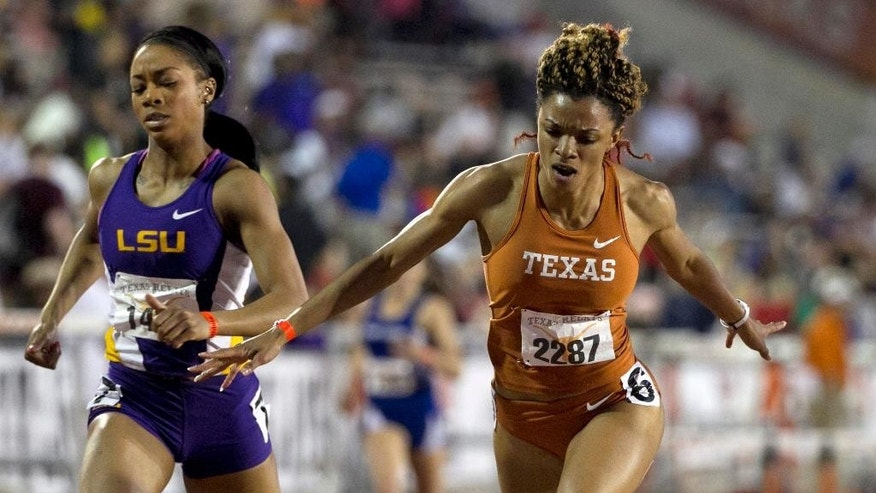 Danielle Dowie, right, of Texas, gets past LSU's Chanice Chase to win the 400 Meter Hurdles at the Texas Relays at Mike A. Myers Stadium in Austin, Texas, on Friday March 28, 2014.   (AP Photo/Austin American-Statesman, Jay Janner)