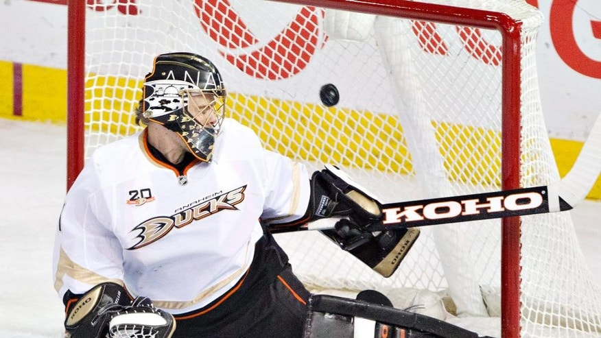 Anaheim Ducks goalie Jonas Hiller (1) is scored on by the Edmonton Oilers during second-period NHL hockey game action in Edmonton, Alberta, Friday, March 28, 2014. (AP Photo/The Canadian Press, Jason Franson)