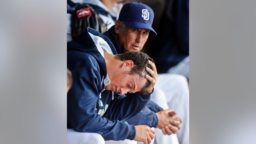 San Diego Padres starter Matt Wisler, foreground, reacts next to manager Bud Black after giving up seven runs in the first inning of a spring  exhibition baseball game against the Cleveland Indians, Friday, March 28, 2014, in San Diego. (AP Photo/Lenny Ignelzi)