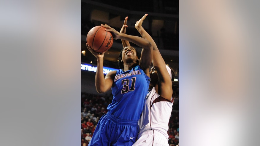 DePaul's Jasmine Penny (31) shoots in front of Texas A&M's Courtney Walker during the second half of a regional semifinal in the NCAA women's college basketball tournament Saturday, March 29. 2014, in Lincoln, Neb. (AP Photo/Dave Weaver)
