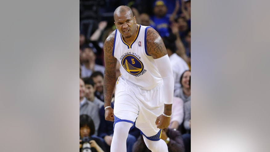 Golden State Warriors forward Marreese Speights reacts after scoring against the Memphis Grizzlies during the first half of an NBA basketball game Friday, March 28, 2014, in Oakland, Calif. (AP Photo/Marcio Jose Sanchez)