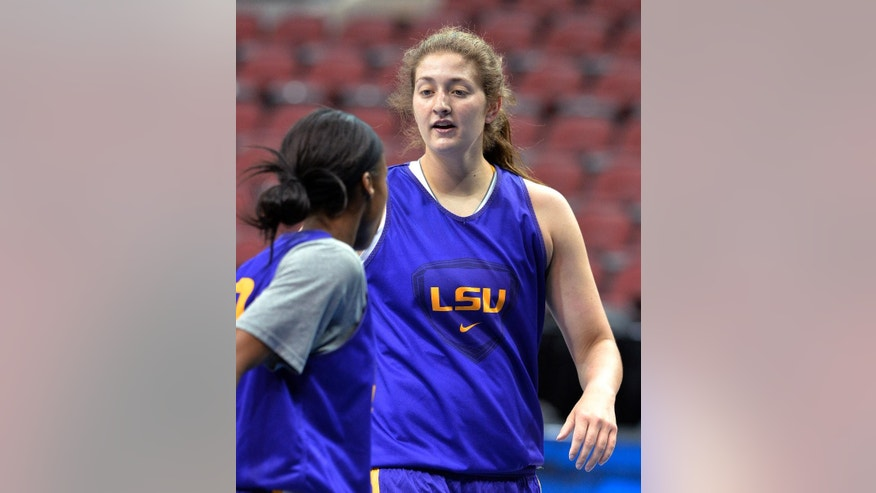 LSU's Theresa Plaisance, right, talks to a teammate during practice at the NCAA women's college basketball tournament in Louisville, Ky., Saturday, March 29, 2014. LSU plays Louisville in a regional semifinal on Sunday. (AP Photo/Timothy D. Easley)