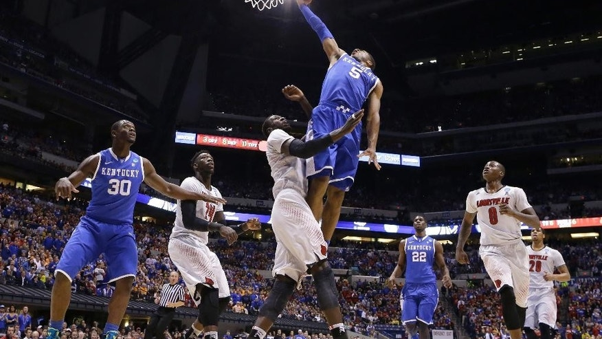 Kentucky's Andrew Harrison (5) shoots over Louisville's Mangok Mathiang during the first half of an NCAA Midwest Regional semifinal college basketball tournament game Friday, March 28, 2014, in Indianapolis. (AP Photo/Michael Conroy)