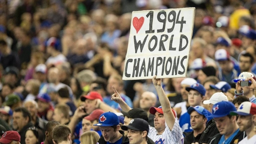 A fan shows his appreciation as members of the 1994 Montreal Expos are honored before an exhibition baseball game between the Toronto Blue Jays and the New York Mets Saturday, March 29, 2014, in Montreal. (AP Photo/The Canadian Press, Paul Chiasson)