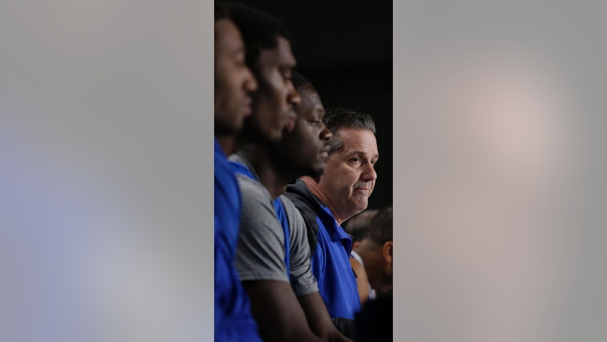 Kentucky head coach John Calipari speaks during an interview session for the NCAA Midwest Regional final college basketball tournament game Saturday, March 29, 2014, in Indianapolis. Kentucky plays Michigan in the final on Sunday, March 30, 2014. (AP Photo/David J. Phillip)
