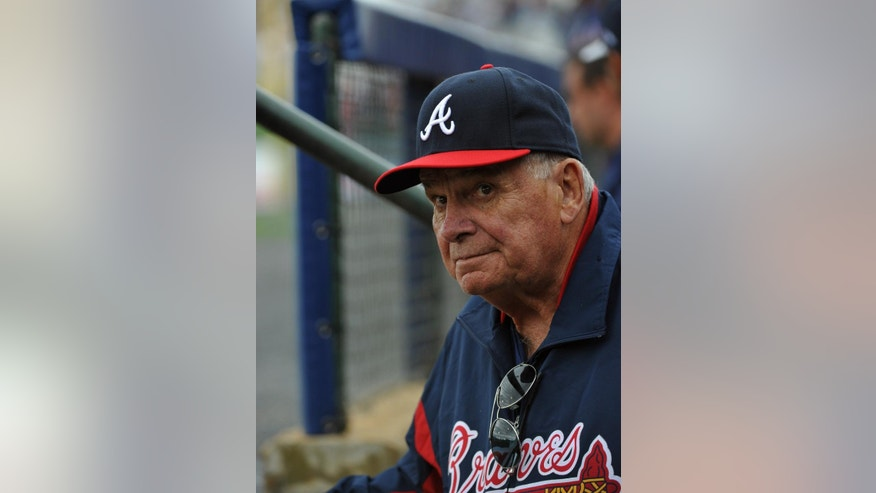Former Atlanta Braves manager Bobby Cox watches from the dugout as he manages the minor league Future Stars against the Atlanta Braves in an exhibition baseball game Saturday, March 29, 2014, in Rome, Ga. (AP Photo/David Tulis)