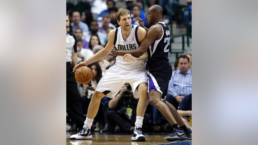 Dallas Mavericks' Dirk Nowitzki (41) of Germany, looks for an opening to the basket against Sacramento Kings' Travis Outlaw (25) in the first half of an NBA basketball game, Saturday, March 29, 2014, in Dallas. (AP Photo/Tony Gutierrez)