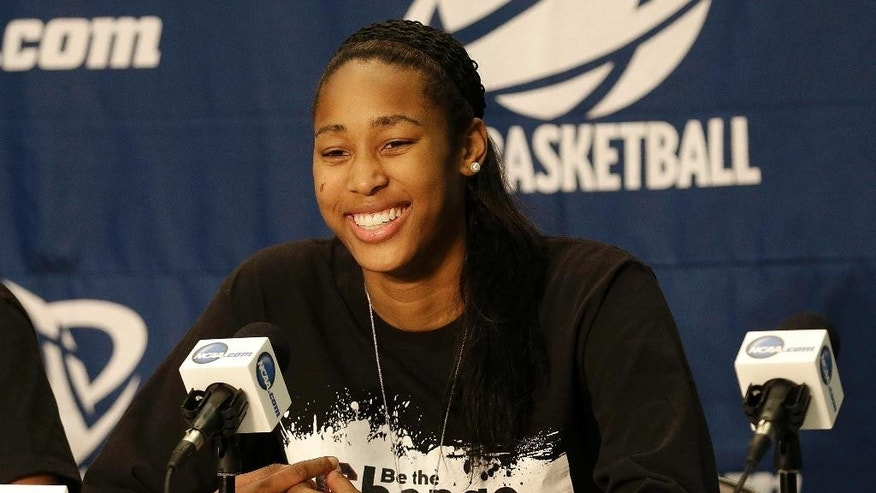 South Carolina center Alaina Coates smiles while speaking during a news conference at the NCAA college basketball tournament in Stanford, Calif., Saturday, March 29, 2014. South Carolina plays North Carolina in a regional semifinal on Sunday. (AP Photo/Jeff Chiu)
