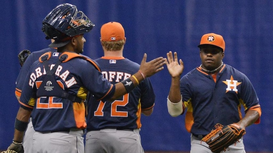 Houston Astros' Delino DeShields, right, celebrates the win with teammate Carlos Corporan after a spring exhibition baseball game against the Texas Rangers on Friday, March 28, 2014, in San Antonio. Houston won 6-5. (AP Photo/Darren Abate)