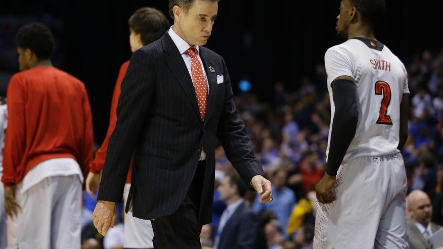 Louisville head coach Rick Pitino walks off after an NCAA Midwest Regional semifinal college basketball tournament game against the Kentucky Saturday, March 29, 2014, in Indianapolis. Kentucky won 74-69. (AP Photo/Michael Conroy)