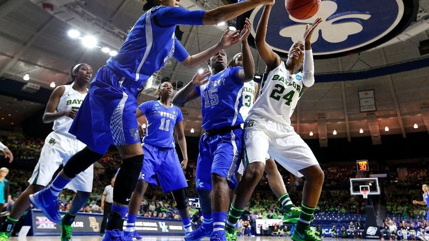 Kentucky's Azia Bishop, left, and Baylor guard Ieshia Small (24) reach for a loose ball during the first half of a regional semifinal in the NCAA college basketball tournament at the Purcell Pavilion in South Bend, Ind., Saturday, March 29, 2014.  (AP Photo/Paul Sancya)