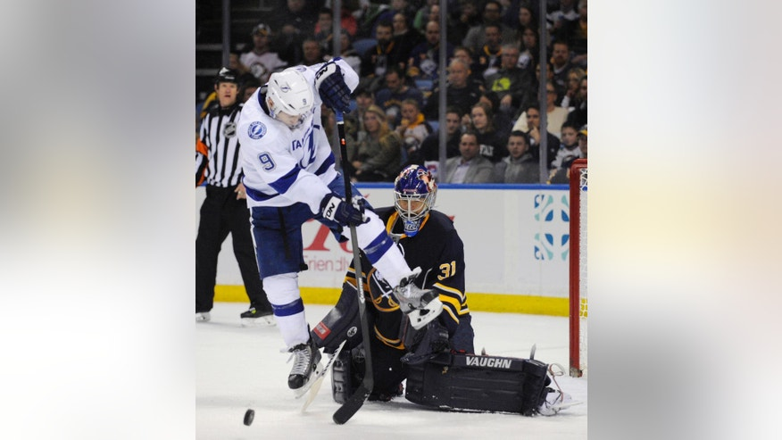 Tampa Bay Lightning center Tyler Johnson (9) gets ready to deflect the puck at Buffalo Sabres goaltender Matt Hackett (31) during the second period of an NHL hockey game in Buffalo, N.Y., Saturday, March 29, 2014. (AP Photo/Gary Wiepert)