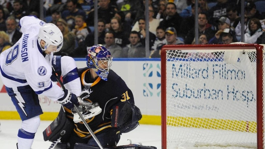Tampa Bay Lightning center Tyler Johnson (9) deflects the puck wide of Buffalo Sabres goaltender Matt Hackett (31) during the second period of an NHL hockey game in Buffalo, N.Y., Saturday, March 29, 2014. (AP Photo/Gary Wiepert)