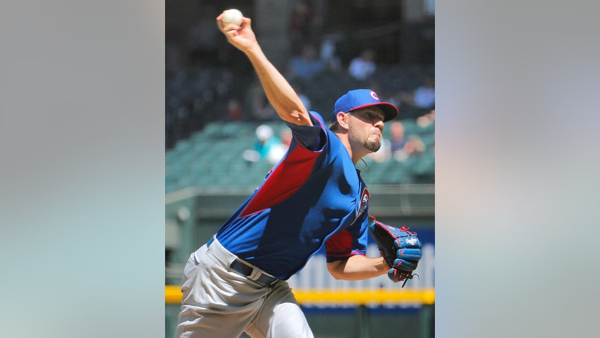 Chicago Cubs pitcher Jason Hammel throws during the first inning of an exhibition spring training baseball game against the Arizona Diamondback , Saturday, March 29, 2014, in Phoenix. (AP Photo/Matt York)