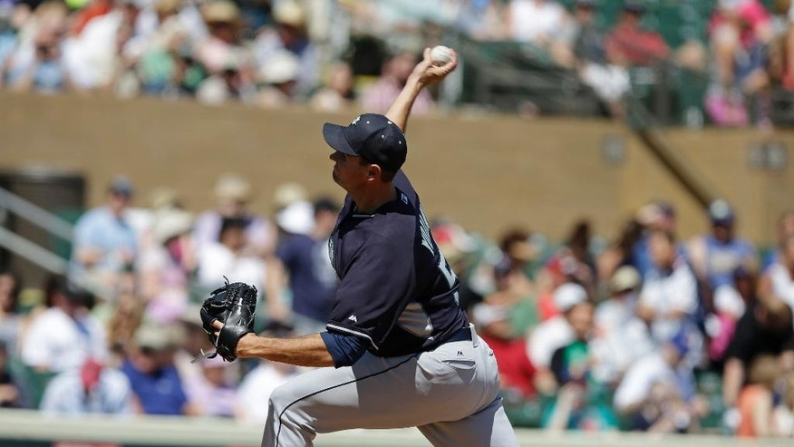 Seattle Mariners' Chris Young throws during the first inning of an exhibition baseball game against the Colorado Rockies on Saturday, March 29, 2014, in Scottsdale, Ariz. (AP Photo/Darron Cummings)