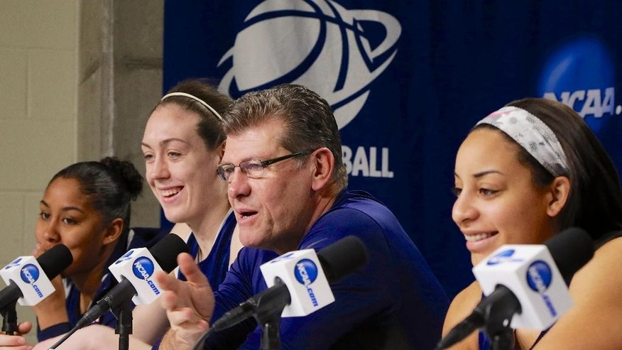 Connecticut coach Geno Auriemma and players Kaleena Mosqueda-Lewis, left, Breanna Stewart, second left, and Bria Hartley, right, participate Sunday, March 30, 2014, in a news conference ahead of a regional finals game in the NCAA college basketball tournament in Lincoln, Neb. Connecticut will play Texas A&M in the finals on Monday. (AP Photo/Nati Harnik)