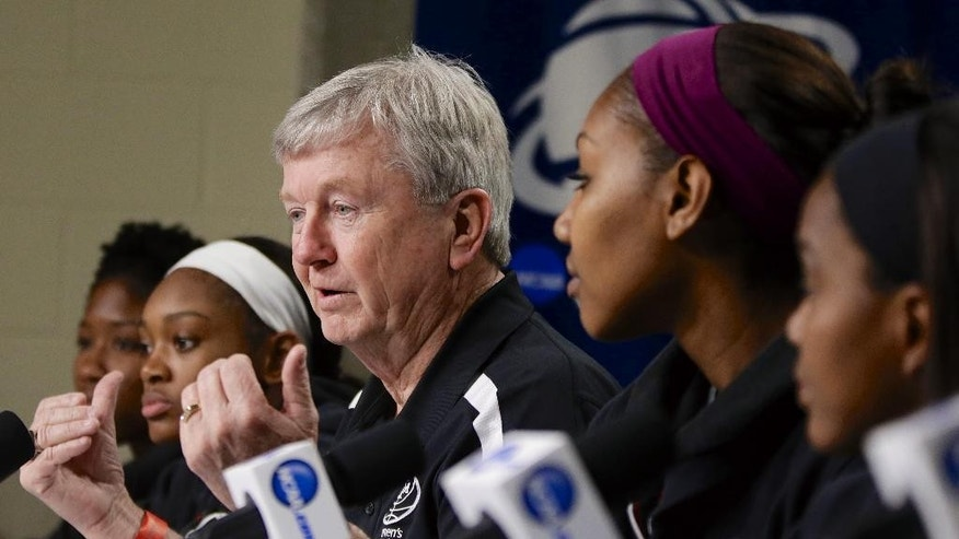Texas A&M coach Gary Blair is flanked by players Kristen Grant, left, Courtney Walker, second from left, Karla Gilbert, second from right, and Jordan Jones, right, as he addresses journalists Sunday, March 30, 2014, at a news conference ahead of a regional finals game in the NCAA college basketball tournament in Lincoln, Neb. Texas A&M will play Connecticut in the finals on Monday. (AP Photo/Nati Harnik)