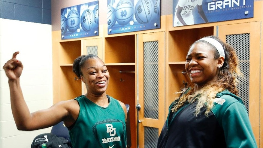 Baylor guard Odyssey Sims, left, and Chardonae Fuqua' talk while waiting for practice Sunday, March 30, 2014, in their locker room in preparation for the NCAA women's college basketball tournament regional final game against Notre Dame on Monday in South Bend, Ind. (AP Photo/Paul Sancya)