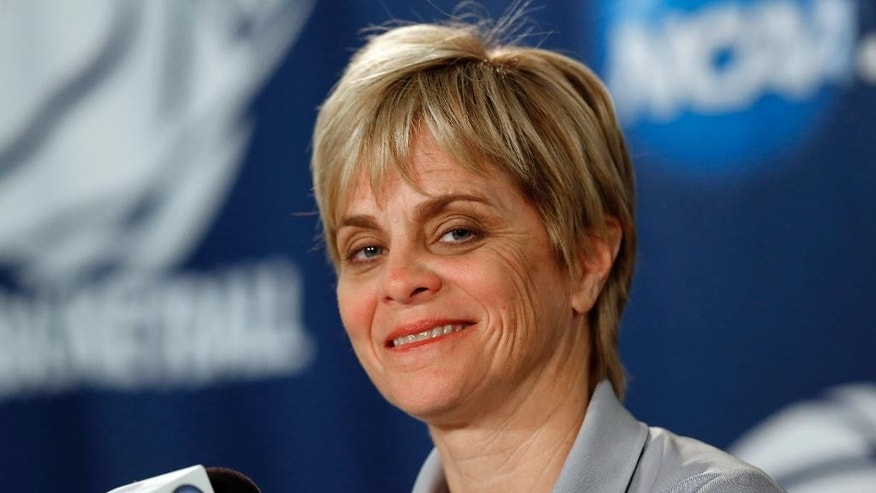 Baylor head coach Kim Mulkey smiles while talking about their NCAA women's college basketball tournament regional final game against Notre Dame on Monday during a news conference at the Purcell Pavilion in South Bend, Ind., Sunday, March 30, 2014. (AP Photo/Paul Sancya)