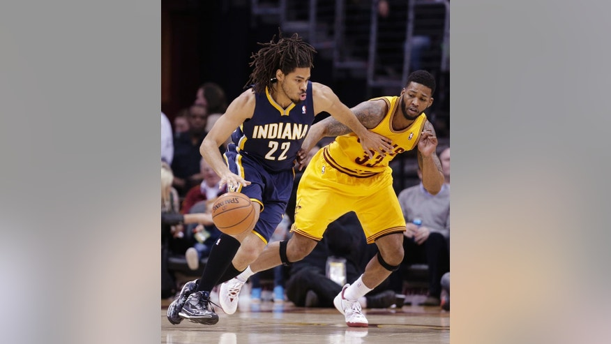 Indiana Pacers' Chris Copeland (22) drives past Cleveland Cavaliers' Alonzo Gee (33) during the second quarter of an NBA basketball game Sunday, March 30, 2014, in Cleveland. (AP Photo/Tony Dejak)