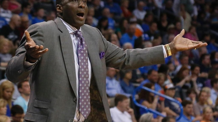 Utah Jazz head coach Tyrone Corbin gestures to an official in the second quarter of an NBA basketball game against the Oklahoma City Thunder in Oklahoma City, Sunday, March 30, 2014. (AP Photo/Sue Ogrocki)