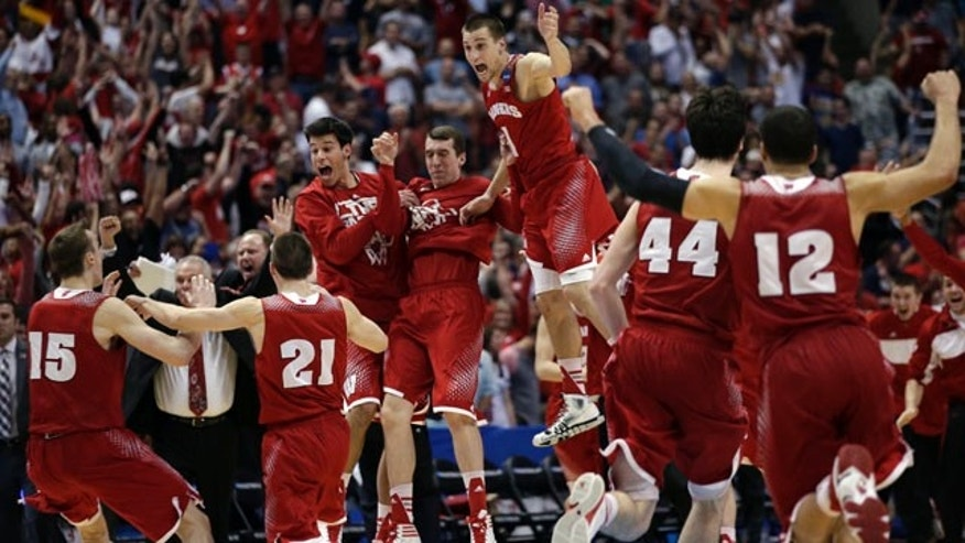 March 29, 2014: Wisconsin players react as time runs out in overtime of a regional final NCAA college basketball tournament game in Anaheim, Calif. Wisconsin won 64-63 in overtime. (AP Photo/Jae C. Hong)