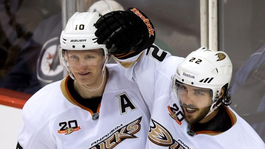 Anaheim Ducks' Corey Perry, left, and Mathieu Perreault celebrate Perreault's goal against the Vancouver Canucks during the third period of an NHL hockey game Saturday, March 29, 2014, in Vancouver, British Columbia. (AP Photo/The Canadian Press, Darryl Dyck)