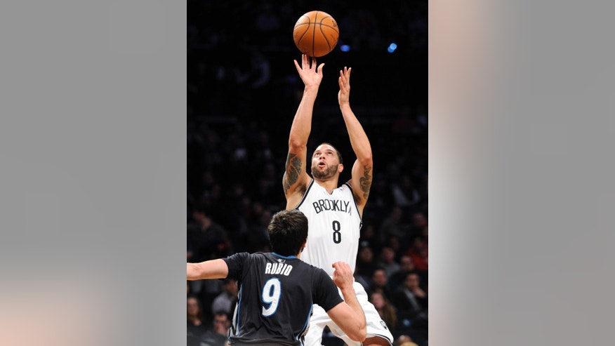 Brooklyn Nets' Deron Williams (8) shoots over Minnesota Timberwolves' Ricky Rubio during the first quarter of an NBA basketball game on Sunday, March 30, 2014, at Barclay's Center in New York. (AP Photo/Bill Kostroun)